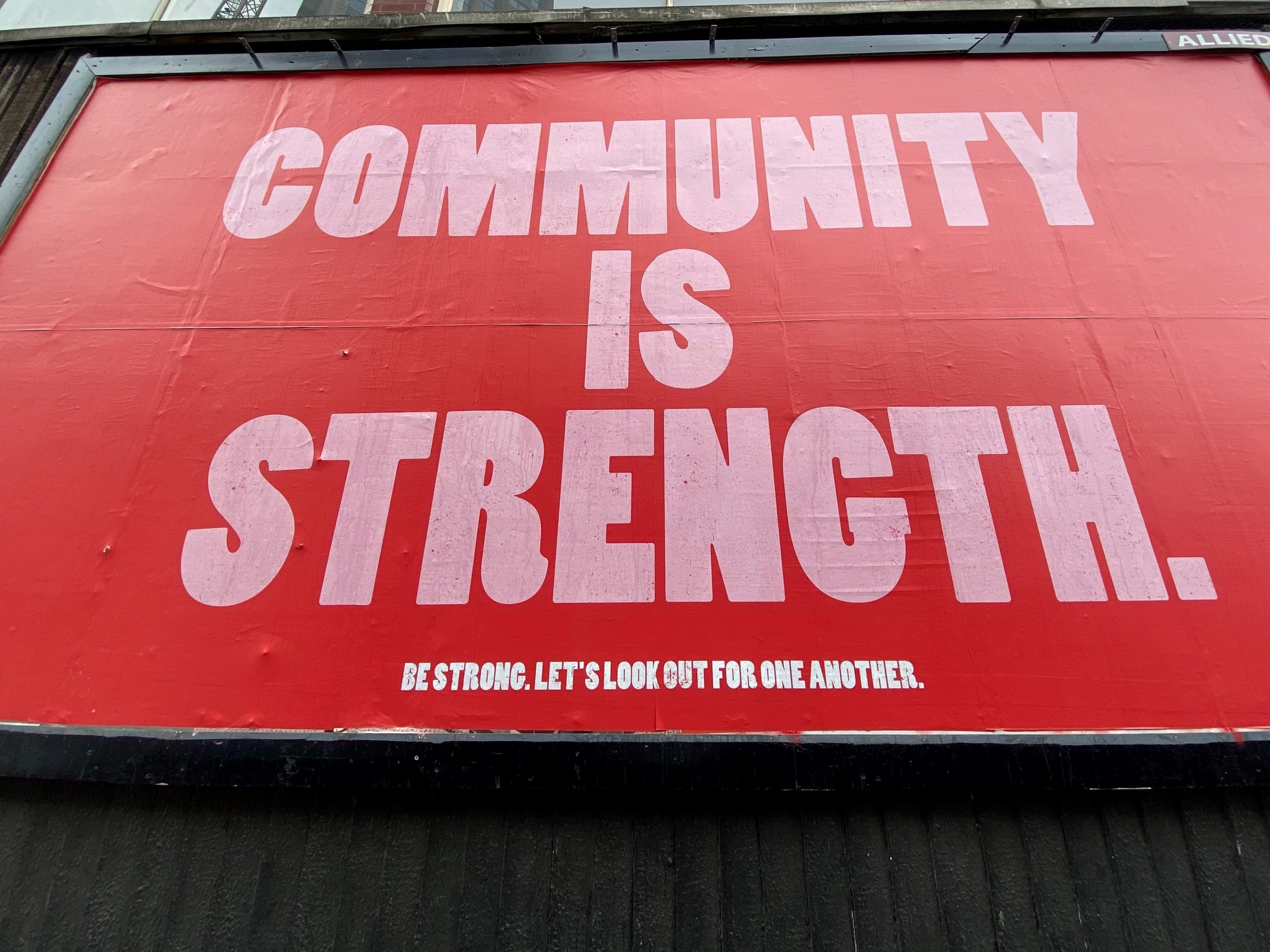 picture of billboard that says community is strength