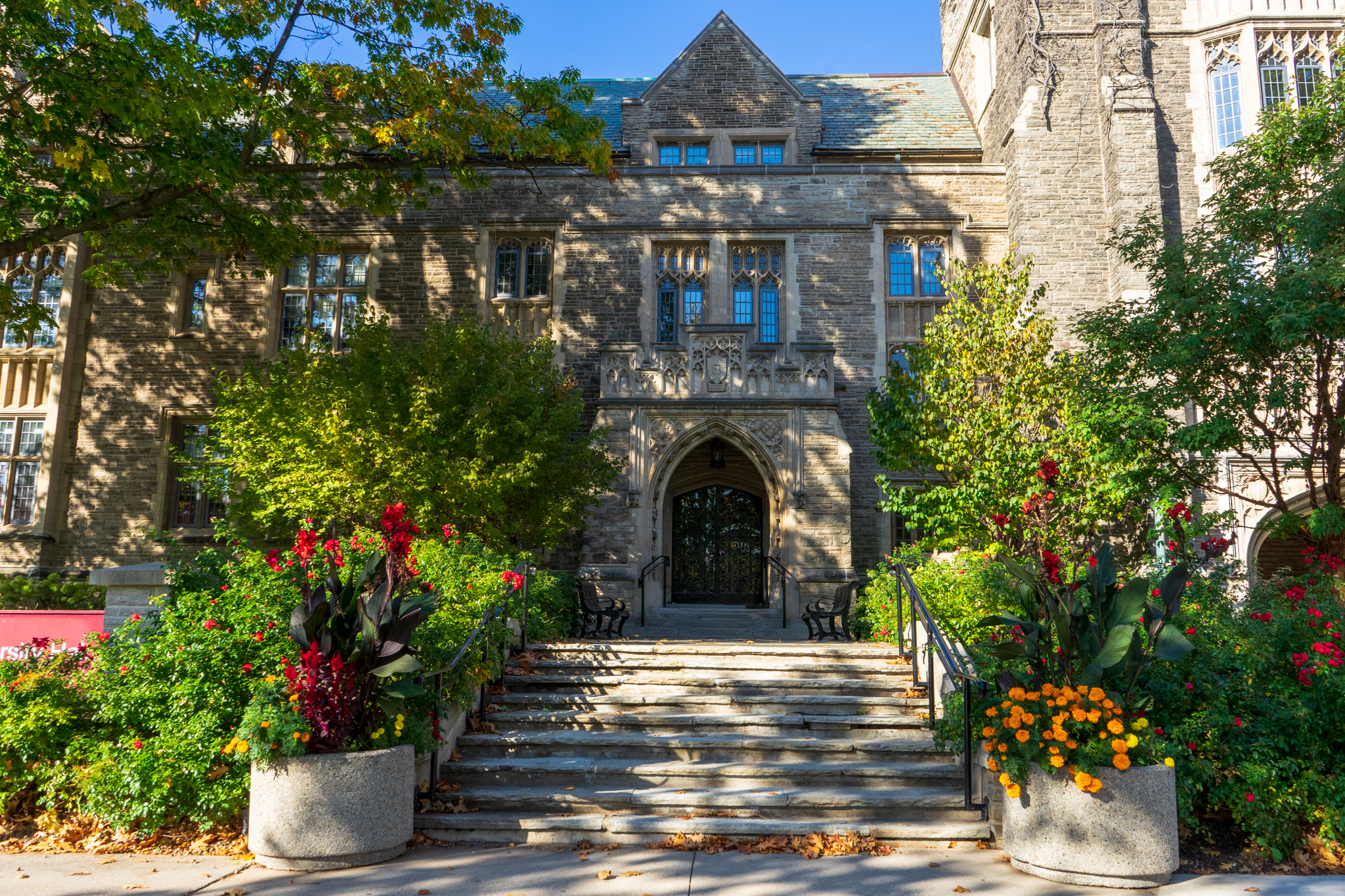university hall in summer steps leading to front doors
